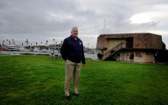 Channel Islands Harbor Director Mark Sandoval is shown at Peninsula Park at  Oxnard harbor. Oxnard and Ventura County, which runs the harbor, are in a dispute over maintenance in certain areas of the harbor. Meanwhile, the city of Oxnard wants a greater say in the future of Fisherman's Wharf.