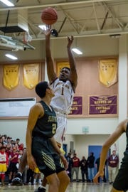 Oxnard's J.R. Waters takes a shot during the Yellowjackets' 61-49 win in a Division 3AA quarterfinal Thursday night.