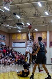 Oxnard's J.R. Waters rises up to take a shot during the Yellowjackets' 61-49 win in a Division 3AA quarterfinal Thursday night.