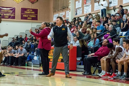 Oxnard head coach Jeff Staniland roams the sidelines during the Yellowjackets' 61-49 win over St. Francis in a Division 3AA quarterfinal Thursday night.