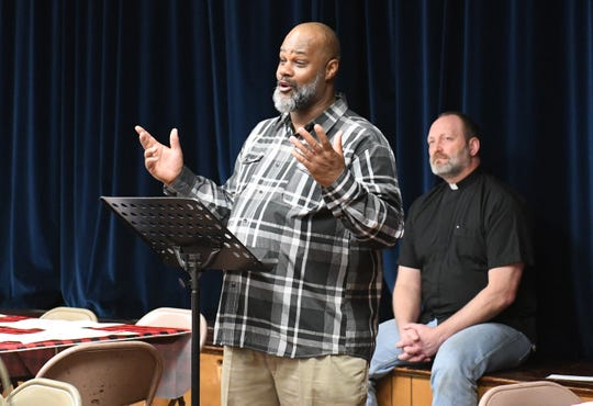 Spirit & Truth Ministries Soup Kitchen volunteer, Thomas Stinson, speaks at a memorial service held for Jeffrey Cuss, who was fatally struck by a car along Landis Avenue.