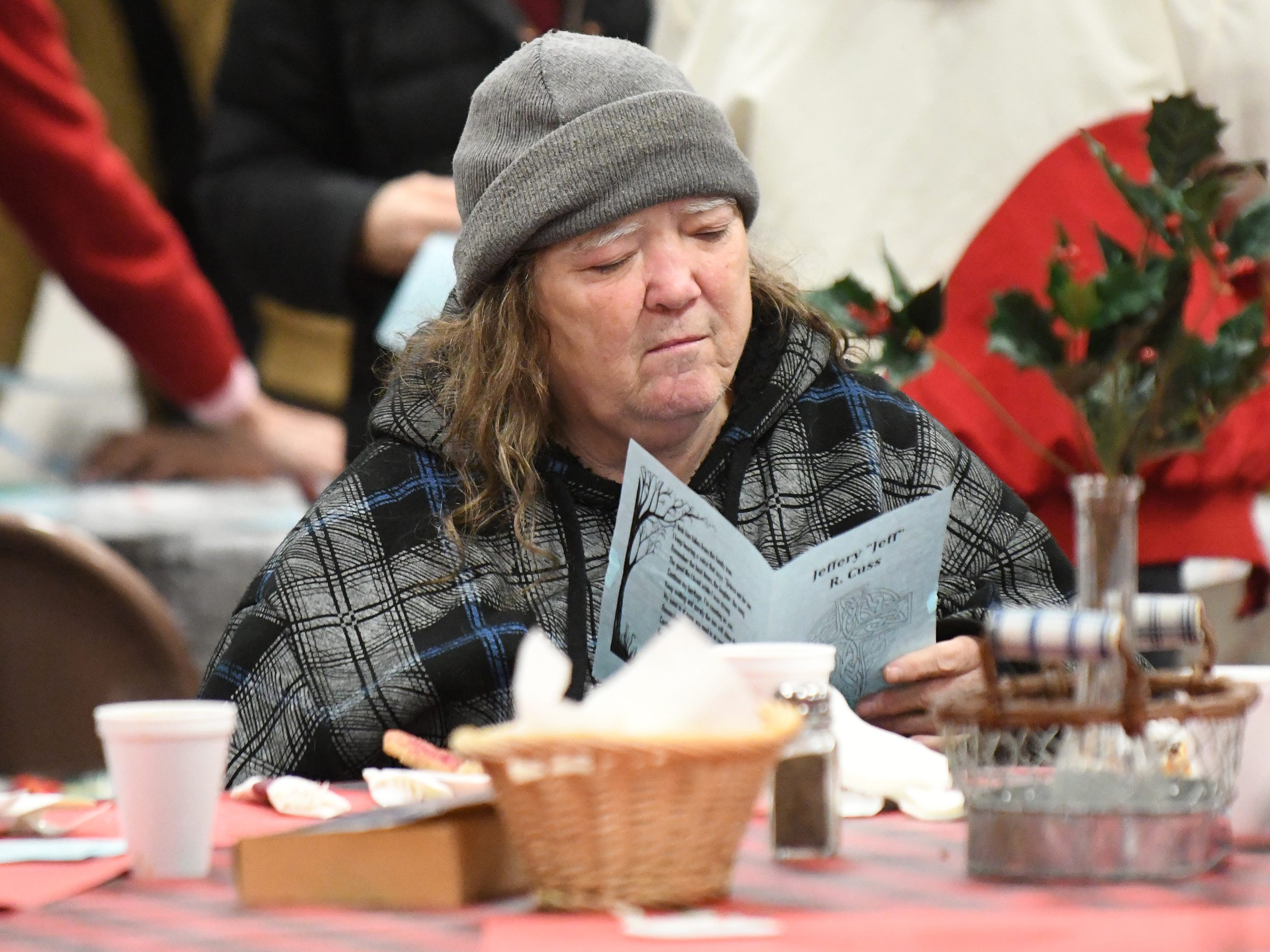 Guests listen to Pastor Michael Denelsbeck speak during a memorial service for Jeffrey Cuss at the Spirit & Truth Ministries Soup Kitchen in Vineland on Thursday, Feb. 14, 2019. Cuss was fatally struck by a car along Landis Avenue.