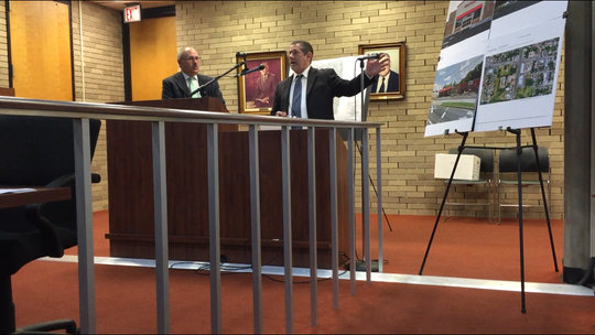 Engineer William Gilmore (right) gestures at displays for a site plan submitted for a Family Dollar store on West Chestnut Avenue in Vineland. Attorney Nate Van Embden (left) is the store chain's attorney on the project. The Planning Board on Wednesday night said no to the idea.