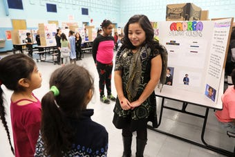 """Fourth and fifth graders at Martin Luther King Jr. Academy in Yonkers act as prominent figures from African-American history, creating a """"live wax museum"""" Feb. 15, 2019."""