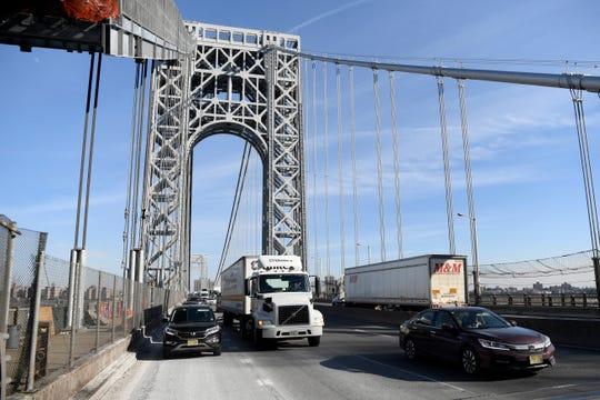 Cars and trucks travel on the George Washington Bridge on Thursday, Feb. 14, 2019.