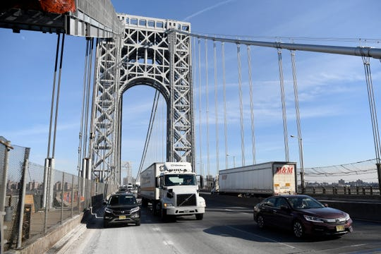 Cars and trucks travel on the George Washington Bridge on Thursday, Feb. 14, 2019.