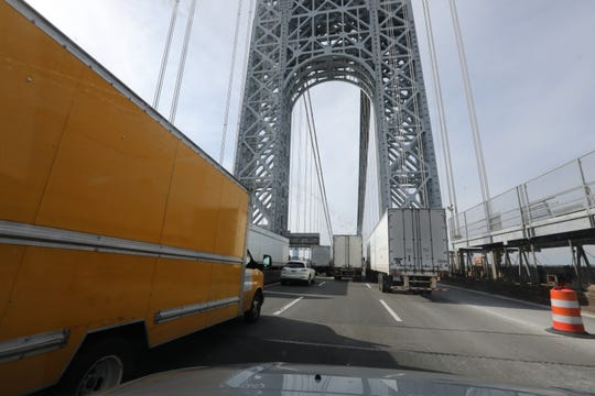 A car is surrounded by trucks as it crosses the George Washington Bridge Feb. 14, 2019.