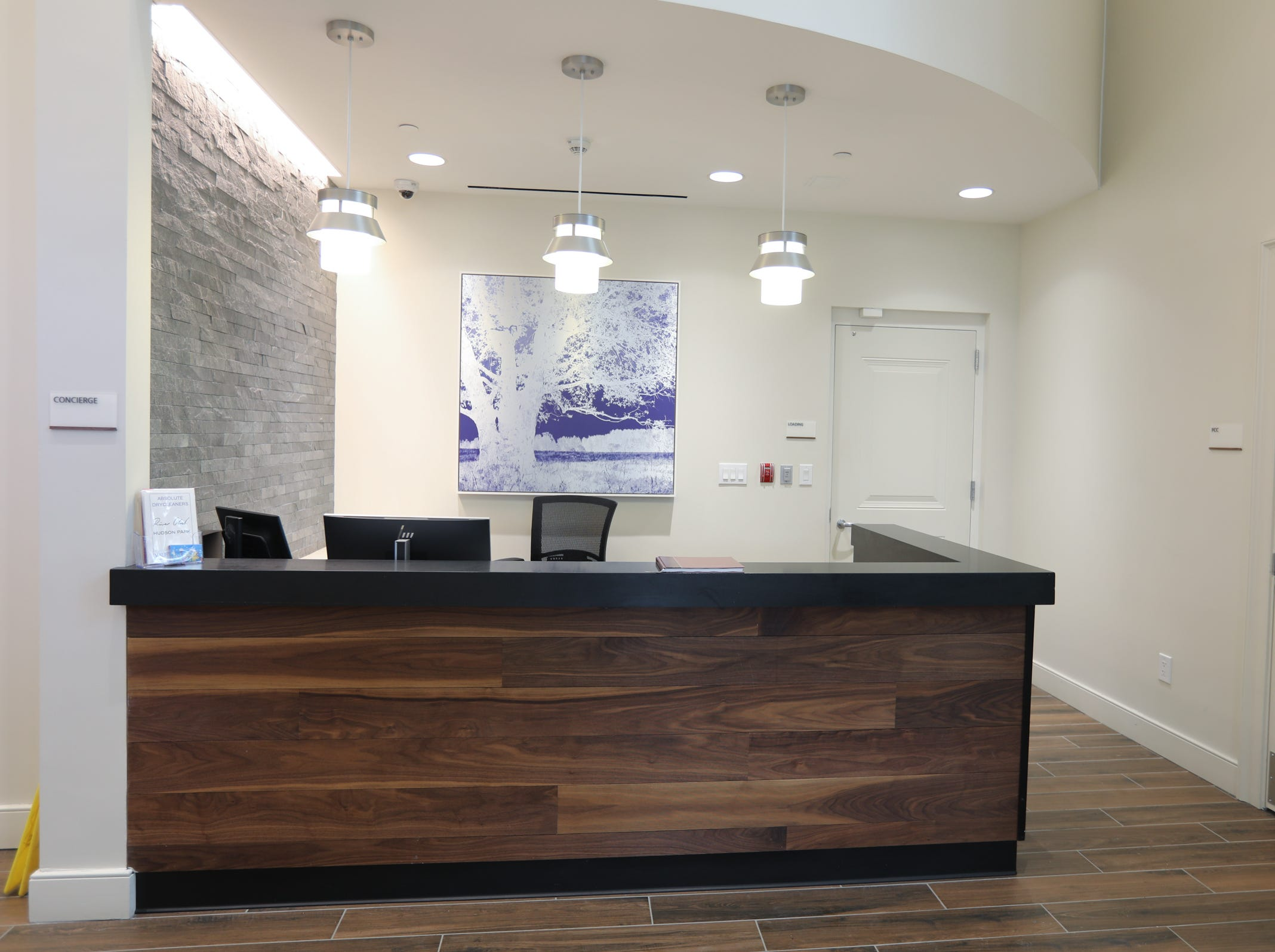 The concierge desk in the lobby at The River Club at Hudson Park in Yonkers on Friday, February 15, 2019.