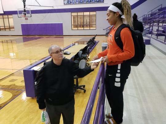 Burkburnett senior Eternity Jackson (right) shares a moment with coach Alex Koulovatos after she played the final game of her Lady Bulldog career.