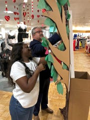 Chrysantate Pryor, lingerie sales department supervisor, and store manager Don Finley (right) set up an Angel Tree in Dillard's located in Sikes Senter on Friday afternoon. The store will be accepting donations to purchase bras for women staying at Faith Refuge.