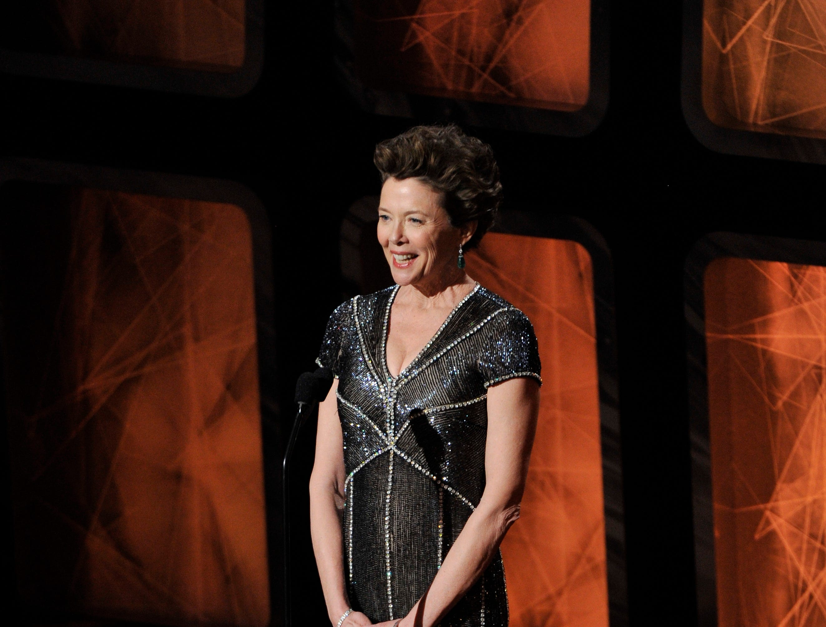 ORG XMIT: RD 39849 2011 OSCARS 2/25/2011  2/27/11 8:05:54 PM -- Hollywood, CA, U.S.A  -- Annette Bening on stage at the 83rd Annual Academy Awards at the Kodak Theatre.   Photo by Robert Deutsch, USA TODAY Staff  [Via MerlinFTP Drop]