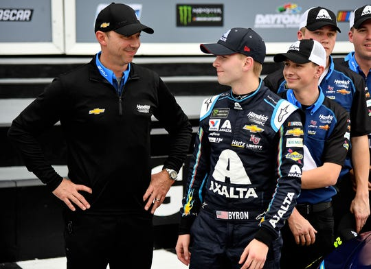 Crew chief Chad Knaus, left, and driver William Byron (R) celebrate after winning the pole for the 61st Daytona 500.