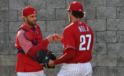 Feb. 14: Phillies pitcher Aaron Nola and catcher J.T. Realmuto in a bullpen session.