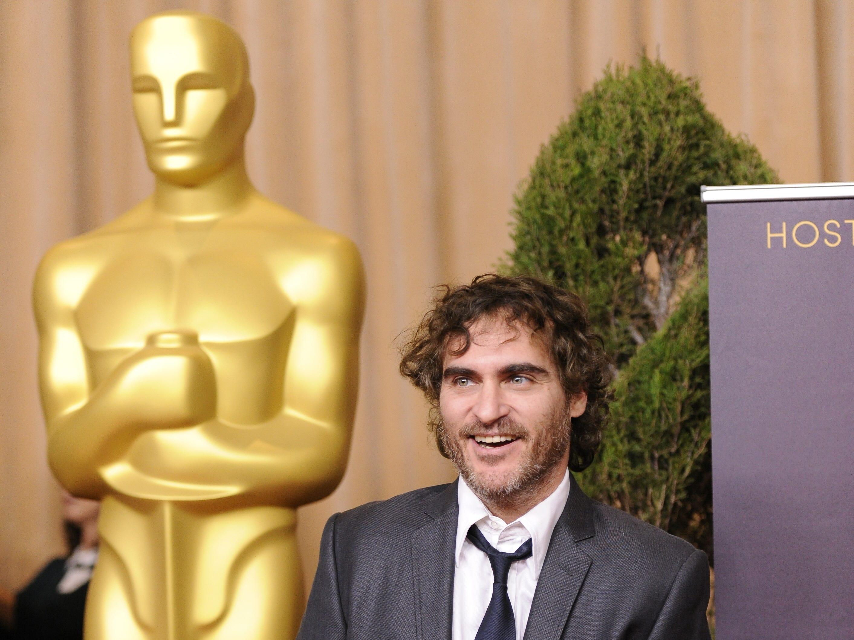 "2/4/13 1:03:44 PM --- ACADEMY AWARDS NOMINEES LUNCHEON --- BEVERLY HILLS, CA: Best actor nominee Joaquin Phoenix (""The Master"") arrives at the Academy Awards nominees luncheon held at the Beverly Hilton Hotel. Photo by Robert Hanashiro, USA TODAY Staff  ORG XMIT: RH 42993 OSCAR LUNCHEON 2/4/2013  [Via MerlinFTP Drop]"