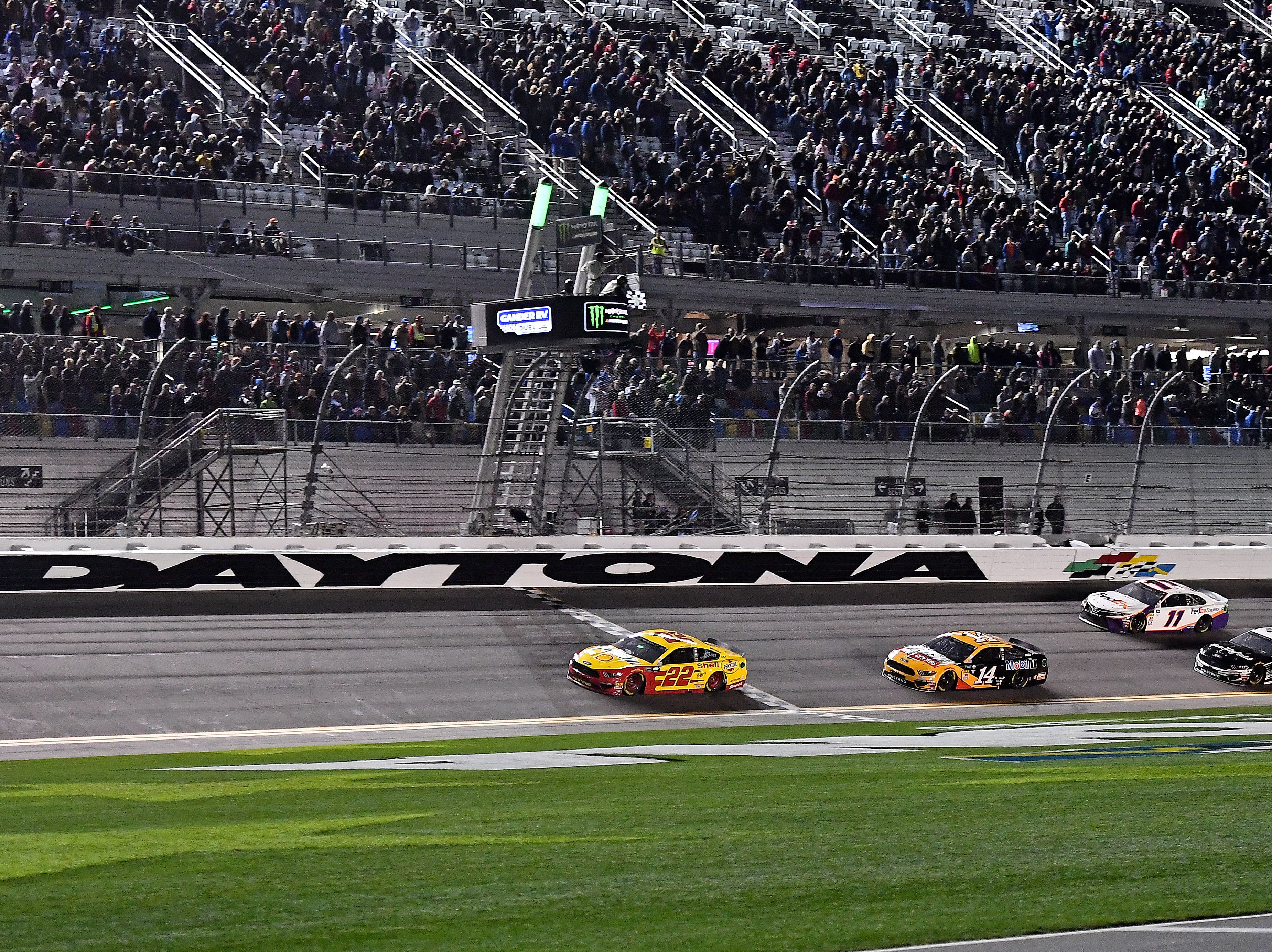 Feb 14:  Joey Logano (22) crosses the finish line ahead of Clint Bowyer (14) to win the Gander RV Duel 2 at Daytona International Speedway.
