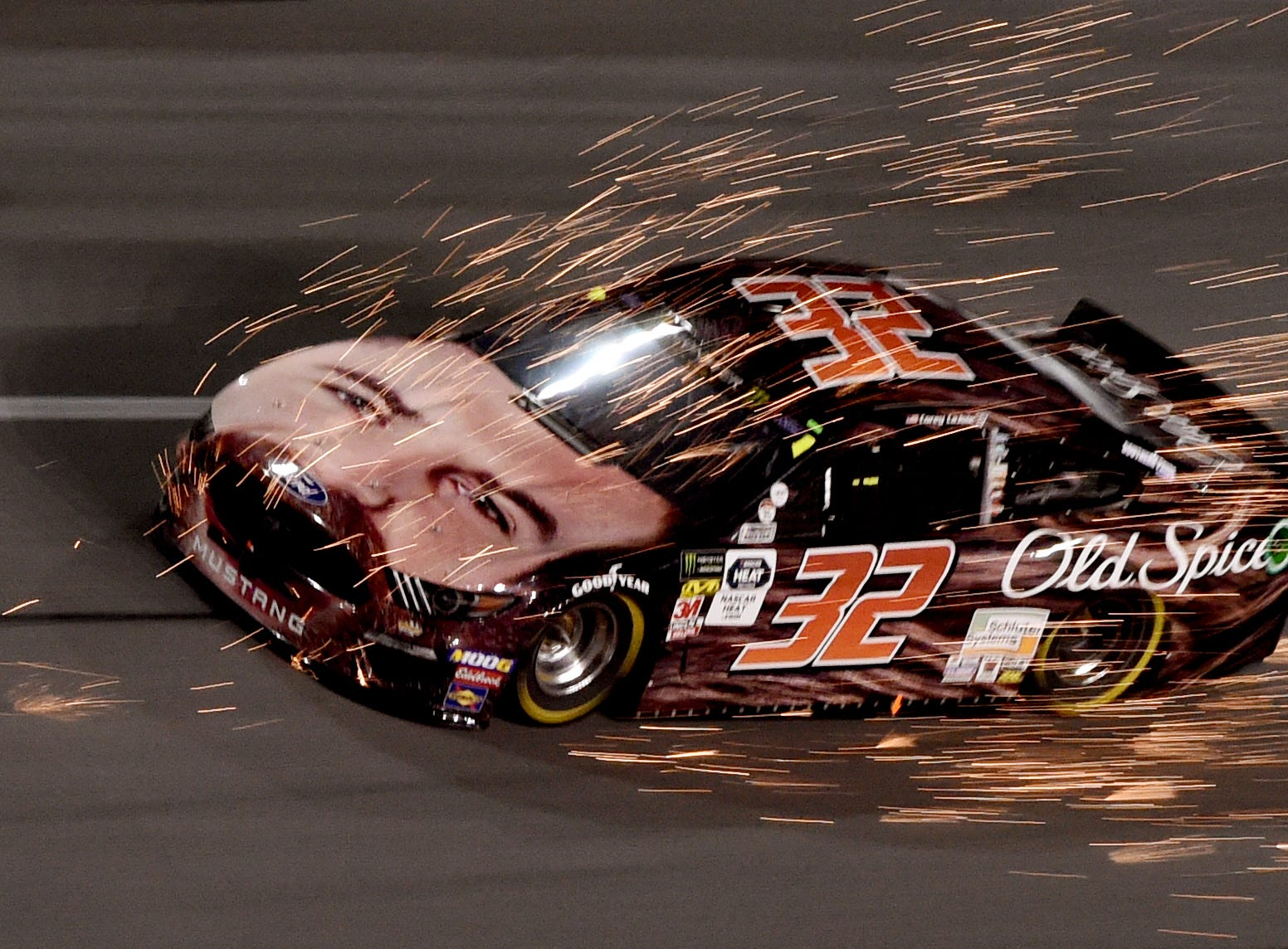 Feb 14: Corey LaJoie (32) gets a front end full of sparks from Casey Mears (not pictured) during the Gander RV Duel 2 at Daytona International Speedway.