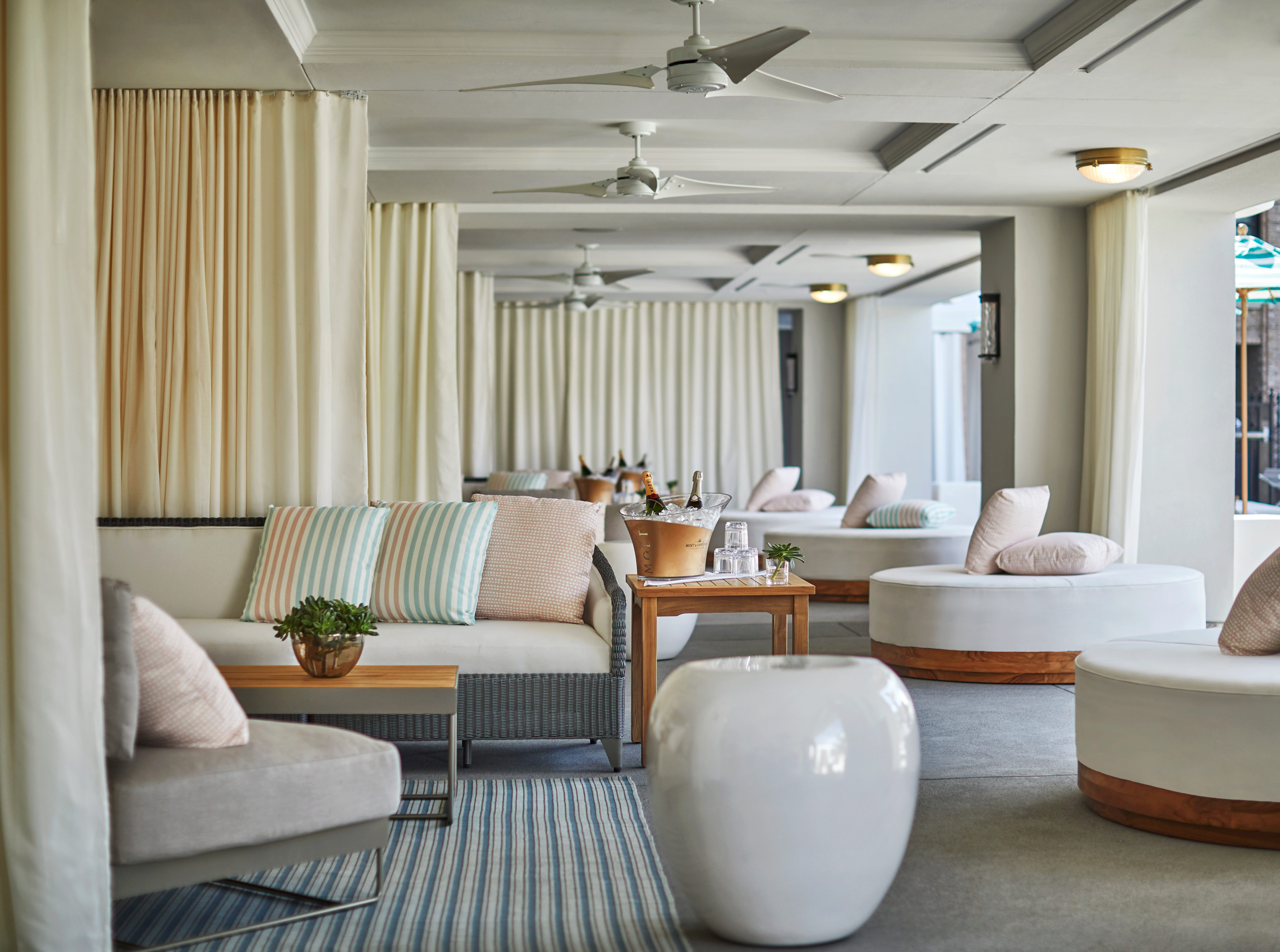 The rooftop Pool House at Pendry San Diego in downtown San Diego offers plush poolside cabanas for $800. The cabanas, which fit 8 to 10 people, includes food and drinks, a dedictated server, TV and a cooler for drinks.