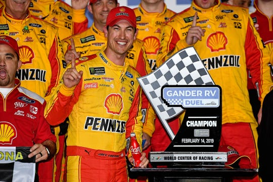 Joey Logano celebrates after winning the Gander RV Duel 2.