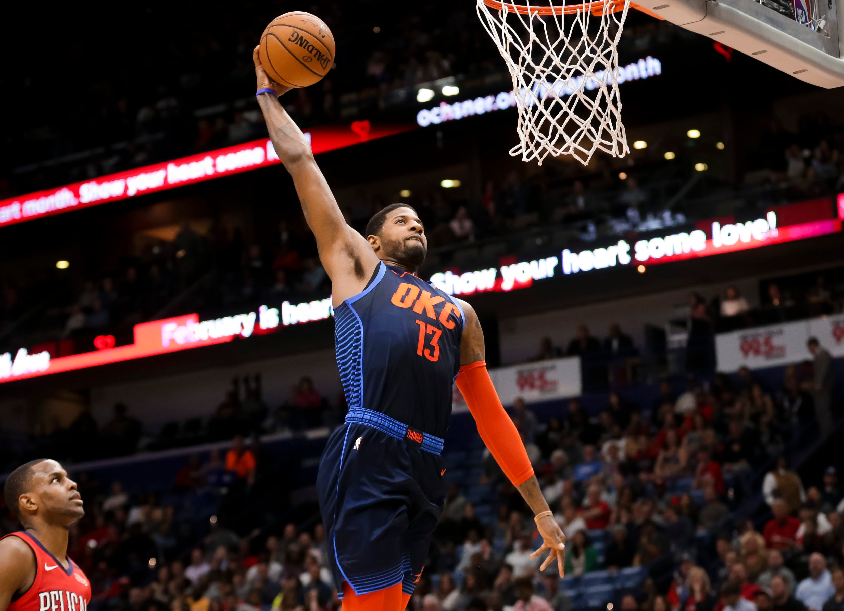 Feb. 14: Thunder forward Paul George rises up for the one-handed flush during the first half against the Pelicans in New Orleans.