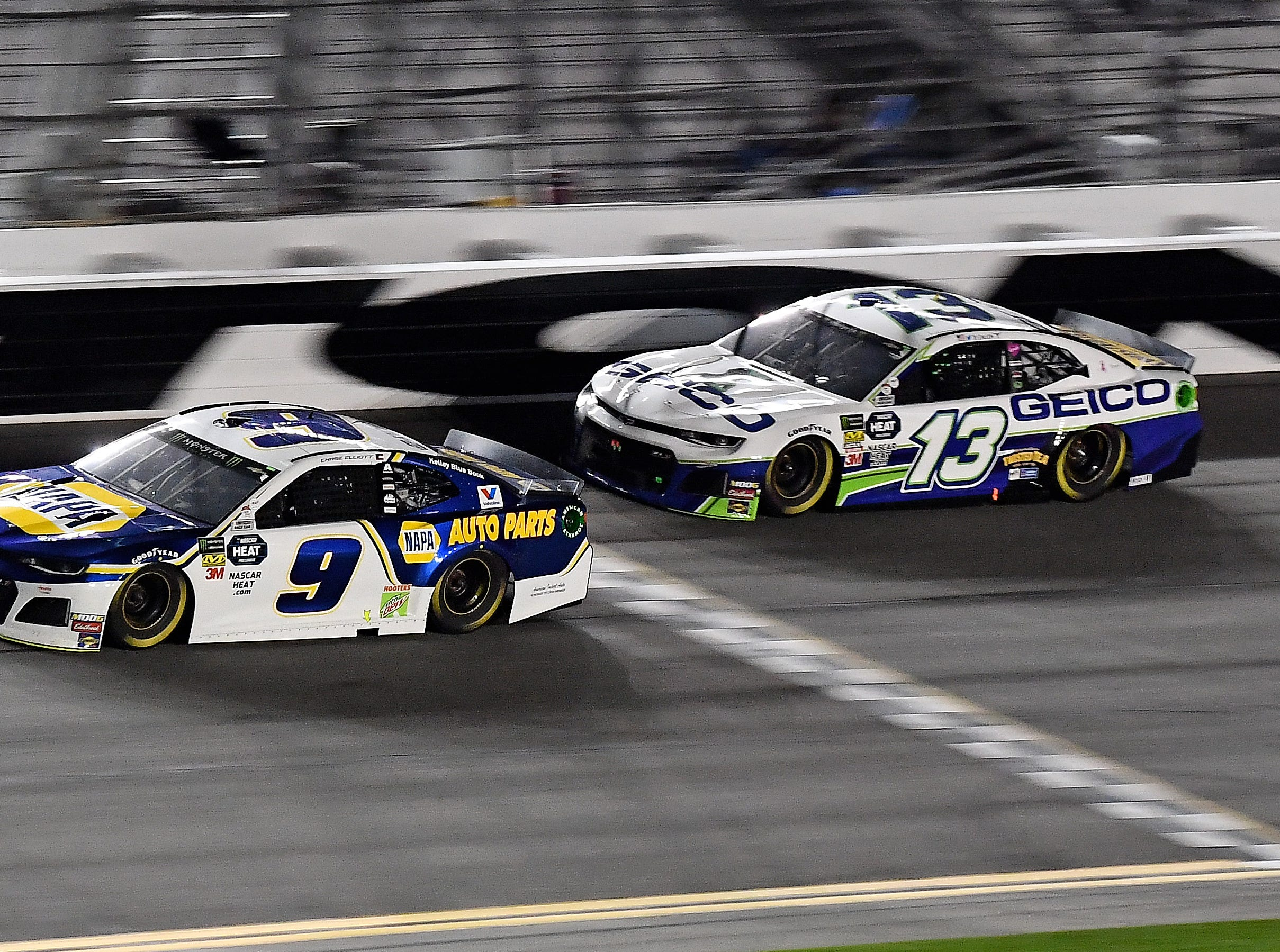 Feb 14: Chase Elliott (9) speeds past Ty Dillon (13) during the Gander RV Duel 2. Elliott finished eighth and Dillon 10th.