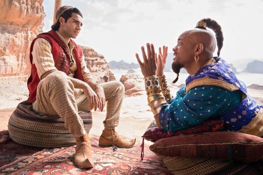 """Newcomer Mena Massoud takes on the role of """"Aladdin,"""" while Will Smith is Genie, seen here in his human form."""