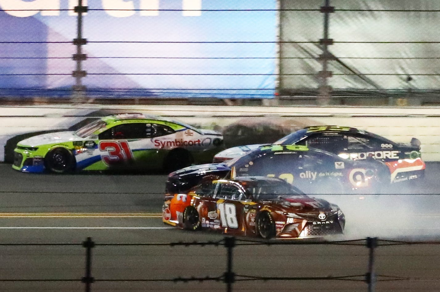 Kyle Busch (18) spins after contact with Jimmie Johnson (48) during the Gander RV Duel 1 at Daytona International Speedway.