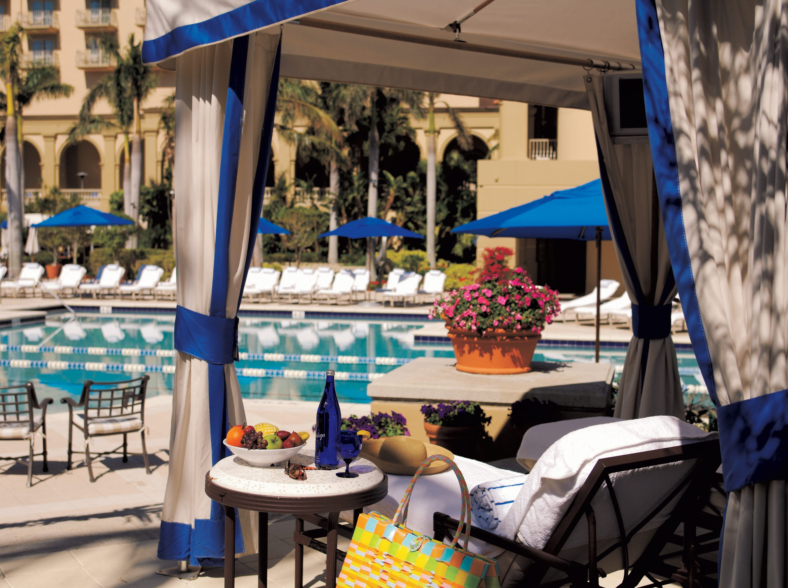 The poolside cabanas at the Ritz-Carlton Naples in southwest Florida. The poolside cabana experience includes a butler, free bottled water and soft drinks, DirectTV, fruit and more.  Regular cabanas start at $399 a day, deluxe cabanas at $599.