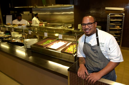 Chef Jerome Grant poses for a photo inside the Sweet Home Cafe at the Smithsonian National Museum of African American History and Culture in Washington. The menu features culturally authentic fare and modern-day-inspired foods. The restaurant is a journey through the agricultural South, Creole coast, Northern states and the Southwest.
