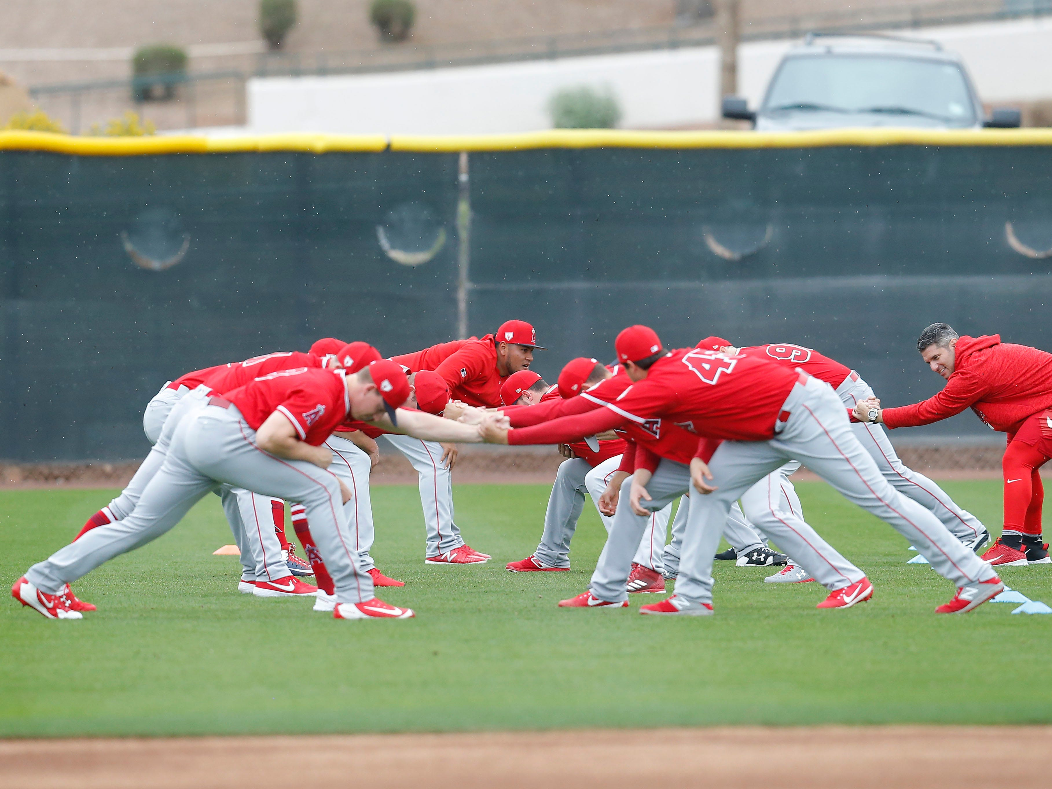 Feb. 14: Angels pitchers stretch at camp at Tempe Diablo Stadium.