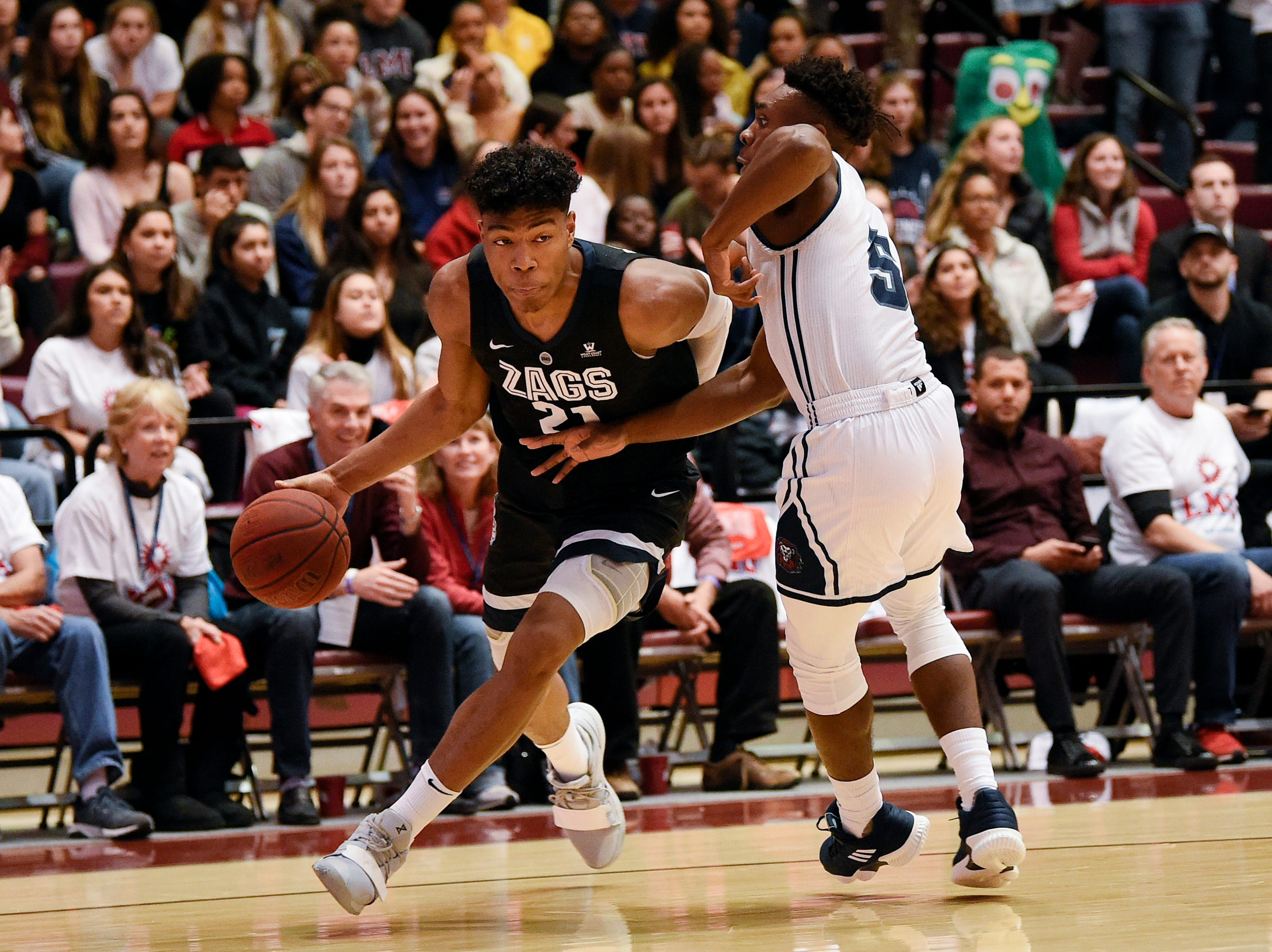 Gonzaga Bulldogs forward Rui Hachimura (21) drives the ball while Loyola-Marymount guard James Batemon (5) defends during the first half at Gersten Pavilion.
