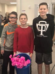 Three boys gave all the girls and staff members at Summit Trail Middle School in Olathe, Kansas, flowers for Valentine's Day.