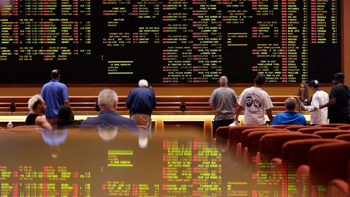 Spread betting on sports from a professional gambler taxes how to bet on horses at the track