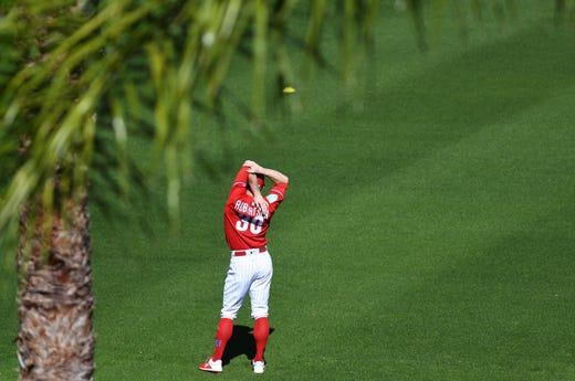 Feb. 14: Phillies' David Robertson   warms up at Spectrum Field.