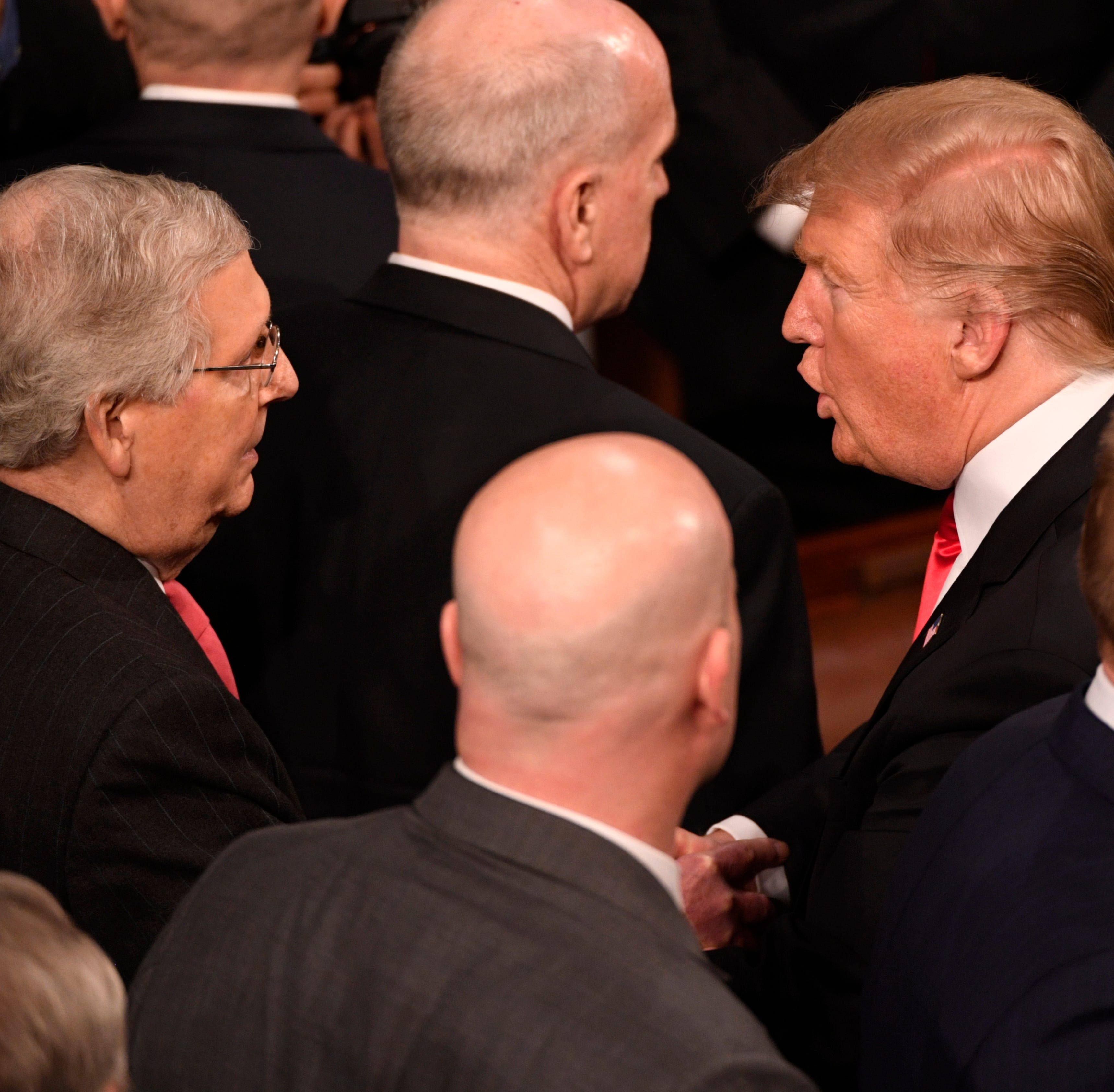 President Donald Trump greets Sen. Mitch McConnell, R-Ky., after he delivered the State of the Union address last week.