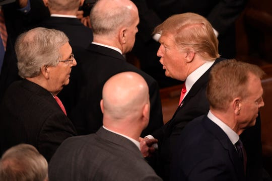 President Donald Trump greets Sen. Mitch McConnell, R-Ky., after he delivered the State of the Union address Feb. 5, 2019.