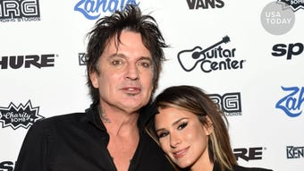 Motley Crue drummer Tommy Lee married social-media star Brittany Furlan on Valentine's Day. The two shared the news on Instagram using a photo of their dogs standing in as bride and groom.