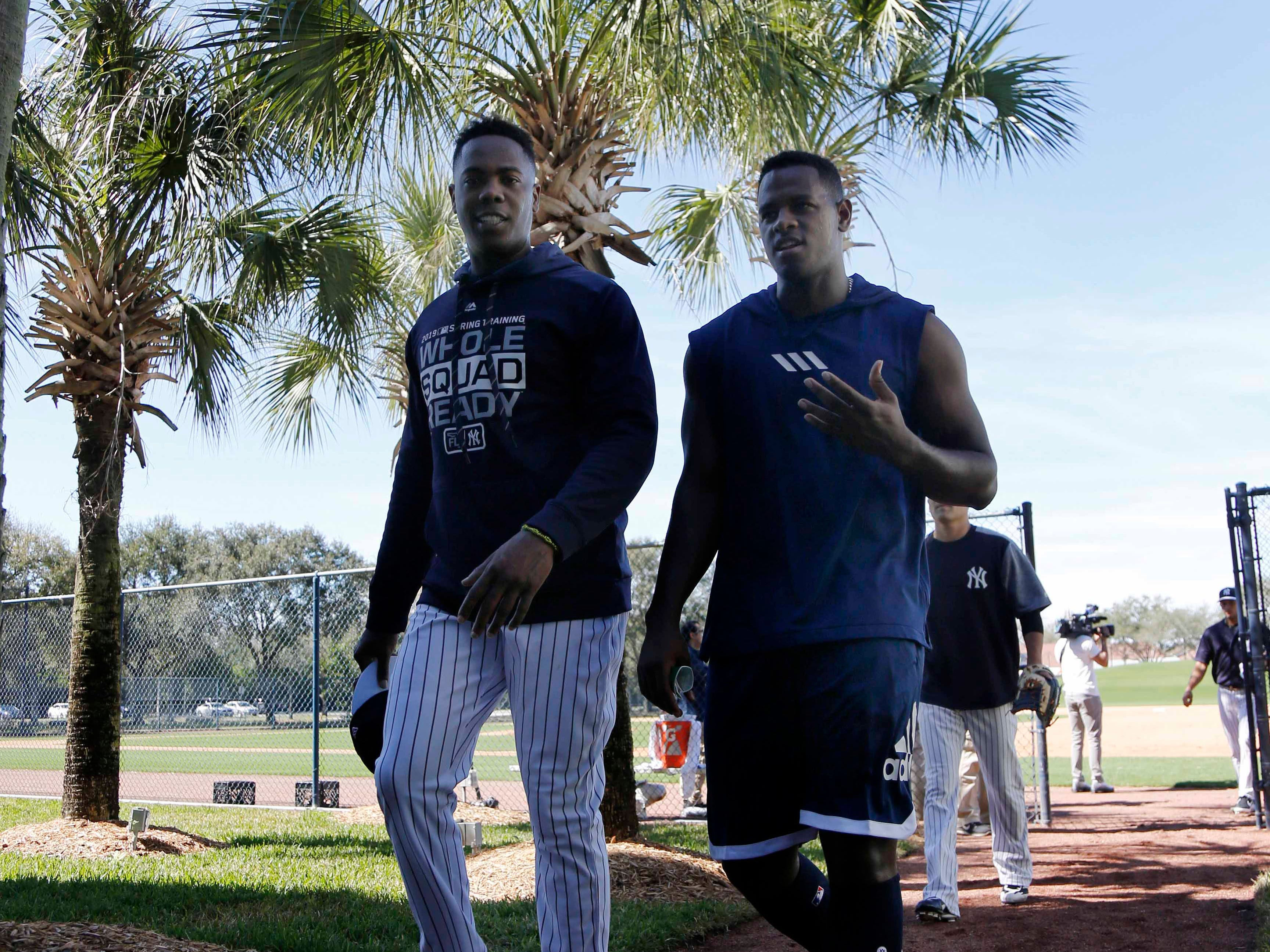 Feb. 14: Yankees closer Aroldis Chapman and starter Luis Severino  walk off the field.