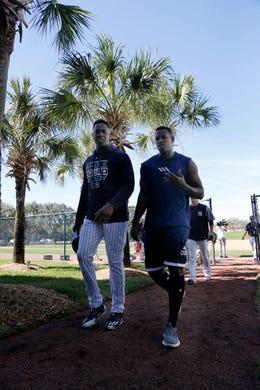 Feb. 14: Yankees closer Aroldis Chapman and starter Luis Severino  walk off the field.
