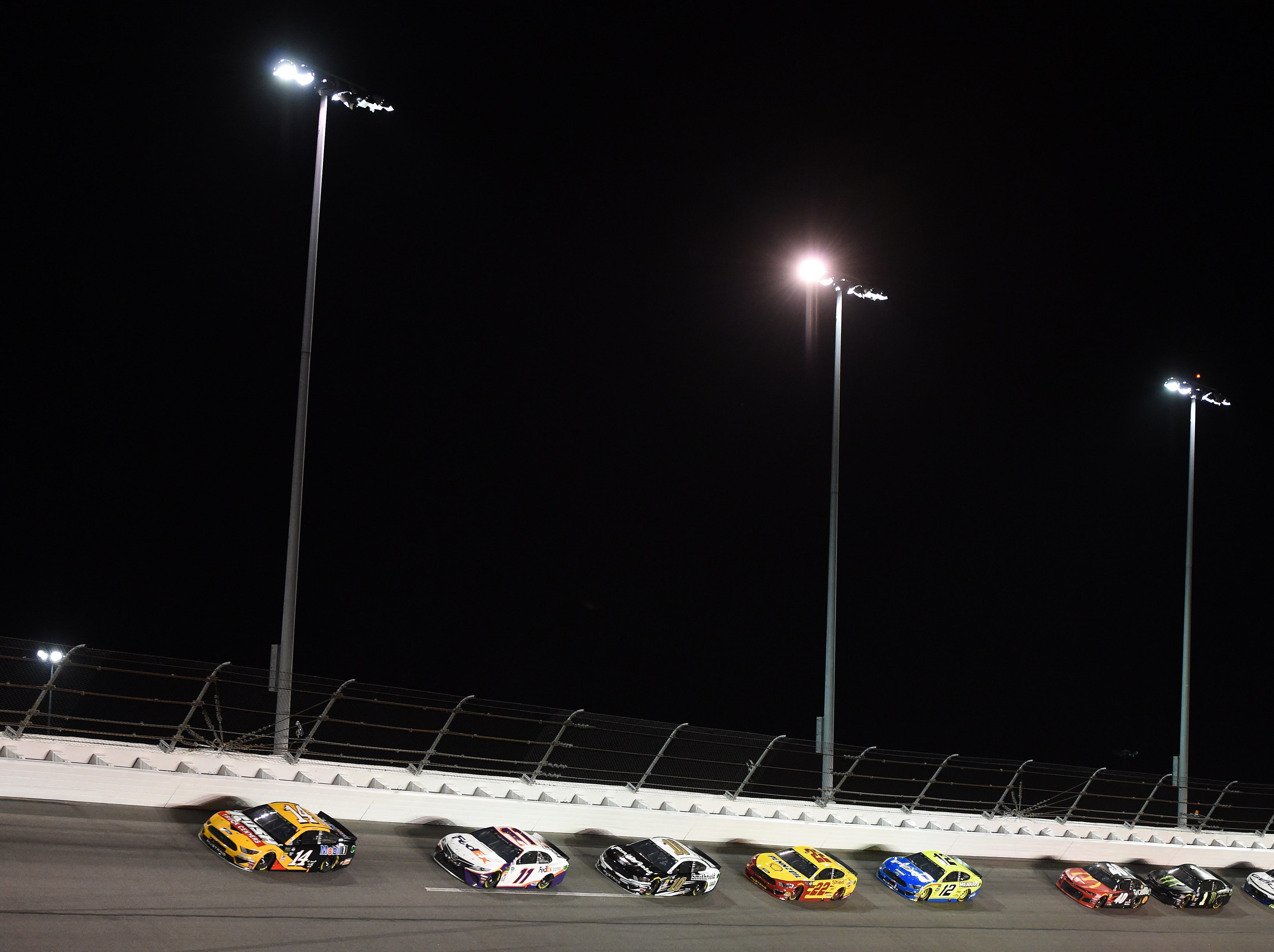 Feb 14: Clint Bowyer (14) leads the pack into Turn 4 during the Gander RV Duel 2. Bowyer led 41 of 60 laps but finished second.