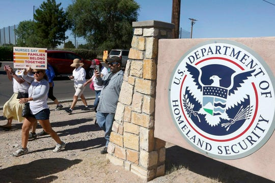 In this June 2018 file photo, protesters walking along Montana Avenue outside the El Paso Processing Center, in El Paso, Texas. On Thursday, Feb. 7, 2019, the United Nations human rights office says the force-feeding of immigrant hunger strikers in a Texas detention facility could violate the U.N. Convention Against Torture.