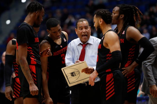 Houston coach Kelvin Sampson talks to his players during a break in the action against the Connecticut Huskies on Thursday. Houston defeated UConn 71-63.