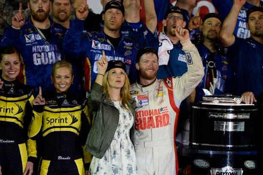 Dale Earnhardt Jr. and then-girlfriend Amy Reimann celebrate his second Daytona 500 win, in 2014.