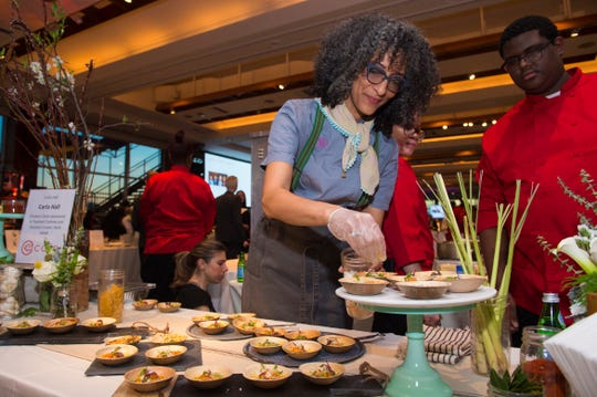 "Chef Carla Hall celebrates the ""greens, beans and grains"" of historical African-American cuisine in her latest book, ""Carla Hall's Soul Food: Everyday and Celebration."""