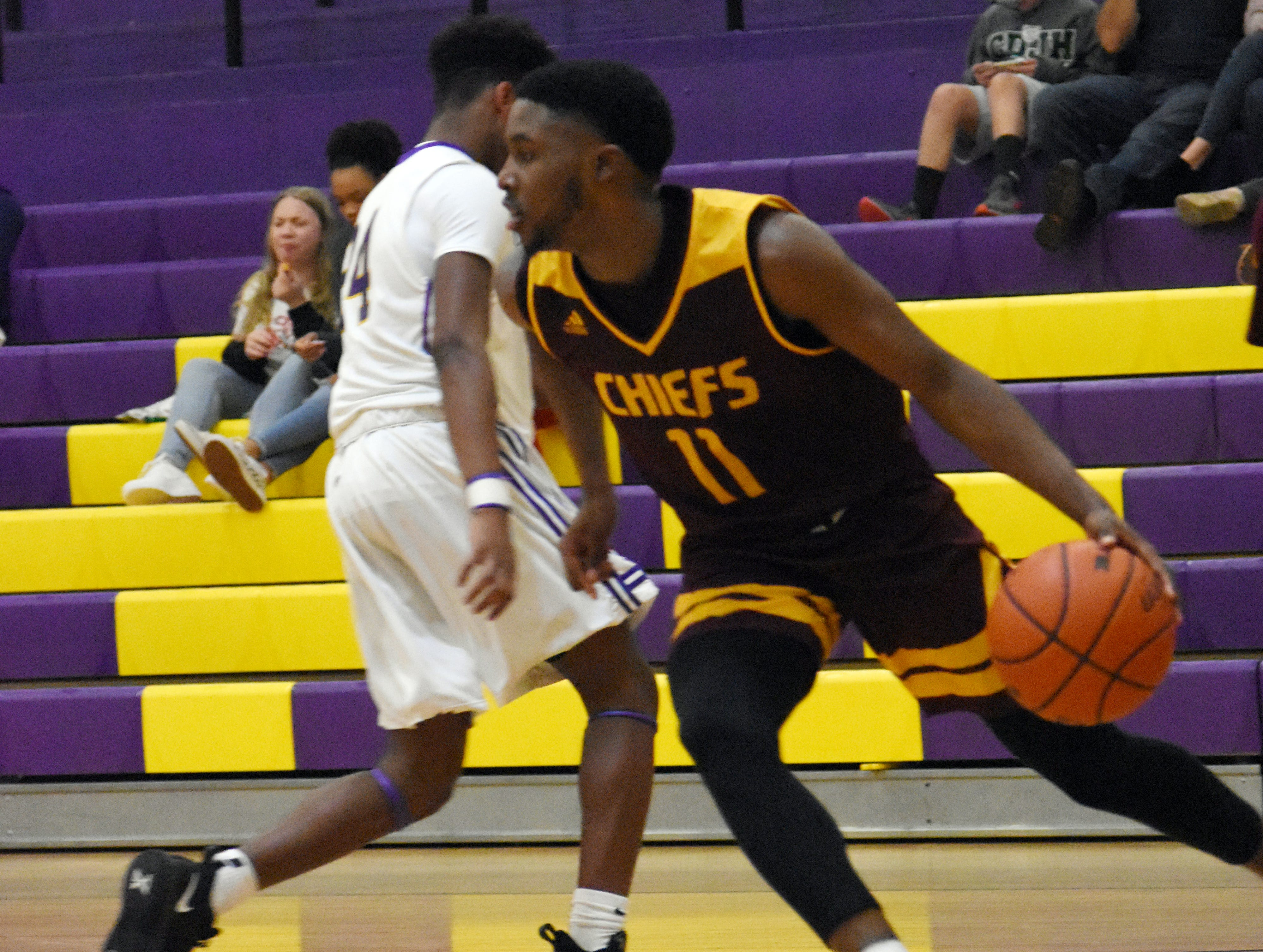 Natchitoches Central's CJ Carpenter (11) drives the ball during a game against Alexandria Senior High School Friday, Feb. 15, 2019. Natchitoches won 62-41.