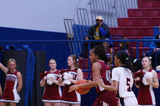 Pineville's Elazia Washington (45) drives in for a layup while West Monroe's MaKayla Glass (5) defends in West Monroe's 58-39 bi-district playoff victory at West Monroe High School on Thursday night.