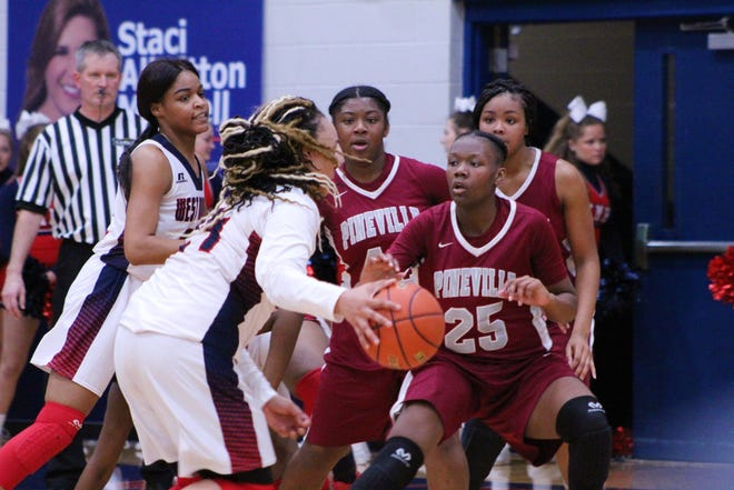 West Monroe's Faith Robinson (24) drives to the lane while Pineville's Aylanna Winn (25) and Elazia Washington (45) play defense in West Monroe's 58-39 bi-district round of the Class 5A playoffs on Thursday night at West Monroe High School.