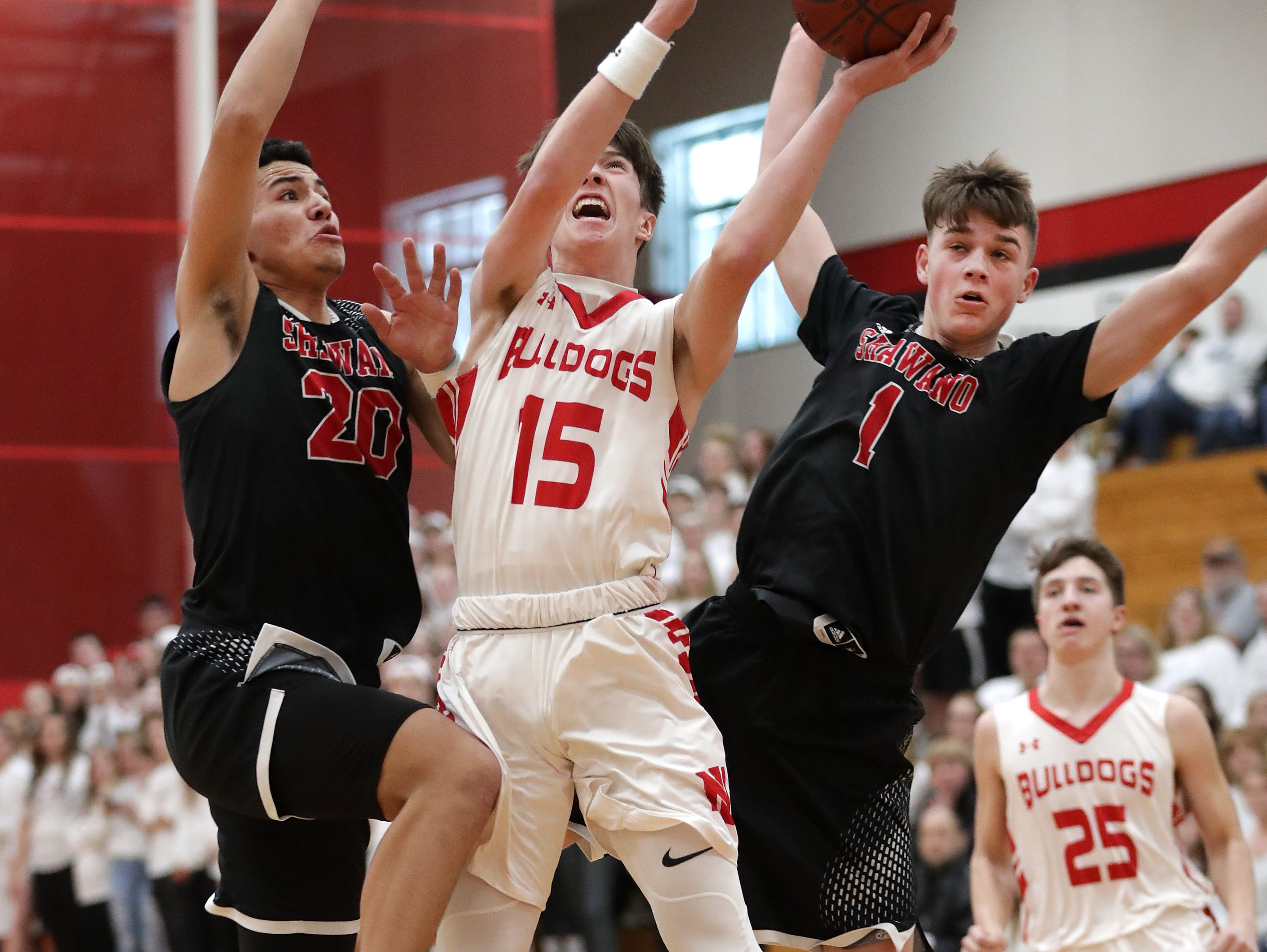 New London High School's #15 Connor Brinkman against Shawano High School on Saturday, February 15, 2019, in New London, Wis. It was the first game for New London since teammate Grant Madsen, from the town of Caledonia, was killed in a car accident on U.S. 45 in Waupaca County on Sunday, February 10, 2019.