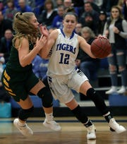 Wrightstown's Meghan Riha dribbles against Freedom's Kenidee Kroening during their North Eastern Conference girls basketball game  Friday in Wrightstown.