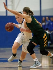 Wrightstown's Bridget Froehlke (1) drives against Freedom's Gabby Johnson during Friday's North Eastern Conference game at Wrightstown. Wrightstown is the top-ranked team in the small-school division of the Post-Crescent's area rankings. Wm. Glasheen/USA TODAY NETWORK-Wisconsin
