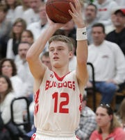 New London High School's #12 Logan Locy against Shawano High School on Saturday, February 15, 2019, in New London, Wis. It was the first game for New London since teammate Grant Madsen, from the town of Caledonia, was killed in a car accident on U.S. 45 in Waupaca County on Sunday, February 10, 2019.Wm. Glasheen/USA TODAY NETWORK-Wisconsin.